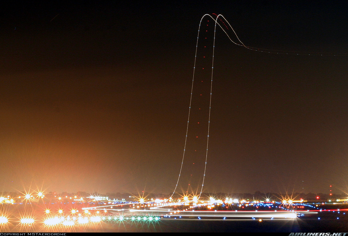 long exposure plane taking off at night